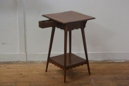 An Edwardian cherrywood writing table, the square top with moulded edge, with pull out inkwell and p