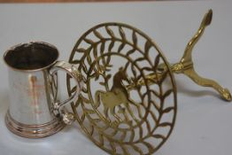 A 19thc Sheffield plated tankard with S scroll handle to side and a brass trivet mounted with horse