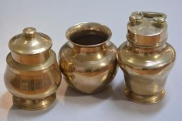An Indian brass food container with carry handle to top, a baluster storage jar and container and a