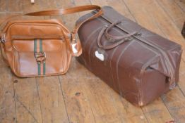 A Thomlinsons Greban leather holdall with twin handles, embossed with initials JFB and a 1970s/80s v