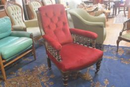 A 19thc mahogany scroll back drawing room easy chair with upholstered button back, arms and seat, in
