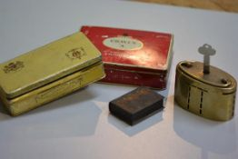 The Union Bank of Manchester oval brass savings bank complete with key, a miniature book box, a ciga