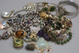 A collection of costume jewellery including jadeite bead necklaces, jadeite buddha style pendant, en