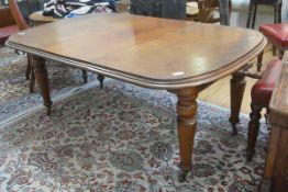 A Victorian walnut telescopic dining table, the top with rounded angles and moulded edge, raised on