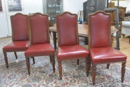 A set of four 19thc mahogany framed upholstered and brass studded panel back side chairs with stuffo