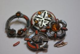 A group of four various Scottish style white metal plaid style brooches mounted with hardstones, cit