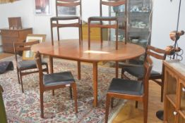 A G Plan 1970s teak seven piece dining suite comprising a circular top extending dining table with m