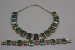 An artisan made white metal necklace mounted fifteen green nephrite panels (59cm, central panel 2cm