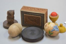 A treen carved miniature owl, a sandalwood Eastern carved box, a treen Indian yellow ball puzzle, an