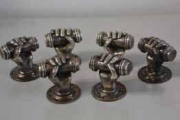 Three pairs of cast brass silvered doorhandles in the form of clenched hands complete with screws et