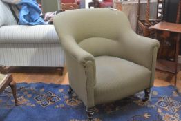 An Edwardian drawing room tub chair upholstered in green and gold check tweed fabric, with button ba
