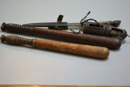 A hardwood truncheon with pierced ringed handle and a treen carved truncheon, a deer hoof handled kn