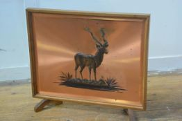 A 1950s South African embossed and appliqued plaque by D Thomson of a gazelle by H.T. Enterprises of