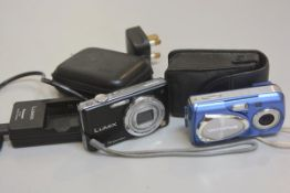 A Panasonic Lumix Hx40 optimal zoom digital camera complete with charger, carry case and an Olympus