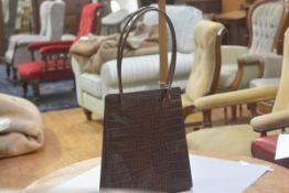 A Marks & Spencer brown embossed leather shoulder bag with satin lining (H.62cm), £20-40