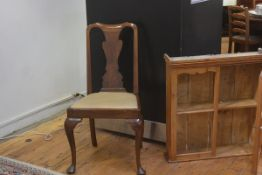A Queen Anne walnut and elm splat back side chair with slip in seat, raised on carved moulded suppor