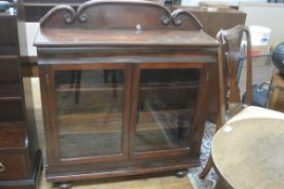A Victorian mahogany ledgeback bookcase top, the twin glazed panel doors enclosing a shelved interio