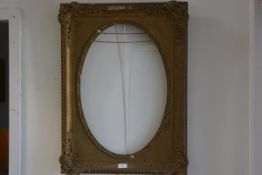 A 19thc. gilt and composition portrait frame with oval aperture with shell and C scroll moulded corn