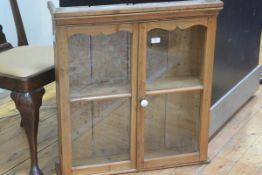A 19thc pine twin glazed door cabinet with moulded cornice, fitted two shelves (h.78cm l.72cm x d.20