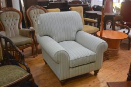 A John Lewis style drawing room easy chair with squab cushions and scroll arms, on walnut fluted tur