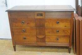 A cherrywood and mahogany Colonial commode, the rectangular top with moulded edge and crossbanded bo