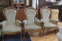 A set of three beech reproduction Victorian style button back drawing room easy chairs upholstered i