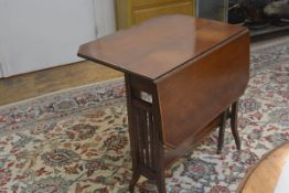 An Edwardian mahogany satinwood crossbanded sutherland tea table with twin drop flaps and cut corner
