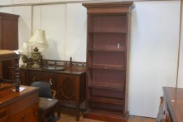 A Colonial teak upright open bookcase, the moulded cornice above an arrangement of five adjustable s