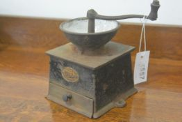A 19thc cast iron Asrnrick & Sons patented coffee mill with enamelled top (h. 16cm), £20-40