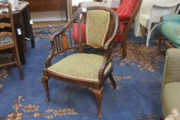 An Edwardian mahogany and beech inlaid panel back tub chair, with inset seat, raised on turned taper