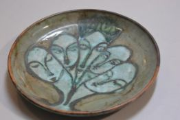 Carolina Valvona, a circular dish with incised jade green glazed heads decoration (d.33cm), £20-40