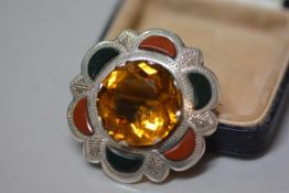 A Scottish sterling silver citrine and hardstone mounted plaid brooch (the circular citrine d. 2.5cm