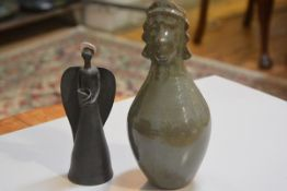 Carolina Valvona, a baluster vase with Aztec style mask top and a terracotta angel figure (2), £20-4