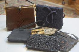 A collection of lady's handbags including a brown snakeskin bag, a black crocodile skin bag, a beade