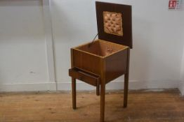 A 1930s walnut sewing box, the square hinged top enclosing a lined interior, fitted single drawer, o