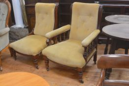A Edwardian pair of lady's and gentleman's drawing room scroll back walnut framed easy chairs with b