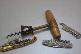 A collection of novelty corkscrews including one with treen handled eagle printed handle, a cast iro