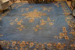 A 1900/1920s Turkey carpet, the centre medallion with radiating lotus flower and leaves, enclosed wi