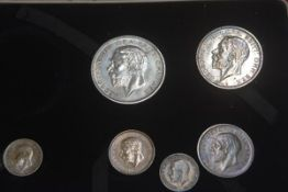 A George V presentation proof set including half crown, florin, one shilling, sixpence, threepence,