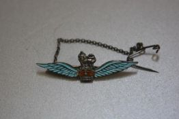 A sterling silver enamelled Royal Airforce sweetheart brooch with safety chain (l.5cm), £30-50