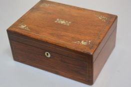 A 19thc rosewood mother of pearl inlaid rectangular workbox enclosing a plain interior (h. 12cm x 27