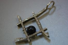 A 1970s Danish silver pendant mounted with bead by Bjorklund Bretners, stamped sterling, Denmark (pe