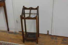 A 1920s oak four division stick stand on square supports, complete with drip tray (h.78cm), £20-30