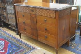 A cherrywood and mahogany Colonial style chest, the rectangular top with moulded edge and crossbande