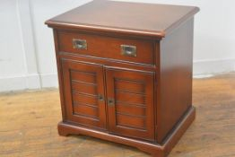 A cherrywood Colonial style bedside, the rectangular top with moulded edge above a single frieze dra