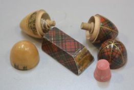 A 19thc mauchline ware McPherson tartan thimble case complete with spool and pink bakelite thimble,