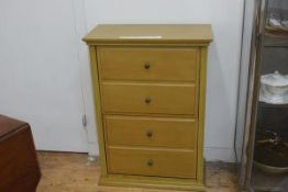 A stained pine shoe cupboard, the rectangular top with moulded edge above two double fronted drawers