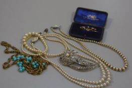 Three various paste pearl necklaces, a gilt metal chain necklace, a marcasite set brooch, a yellow m