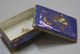 A W&R Caltonware rectangular lustre butterfly and spider's web decorated cigarette box (h.7cm x l.15