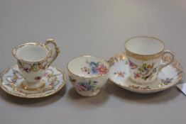 A Dresden porcelain handpainted gilded scalloped cup and saucer, with floral decoration, a Dresden p